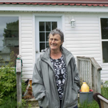 woman in front of house