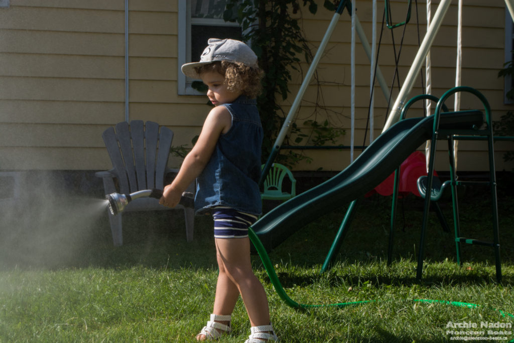 annette using garden hose